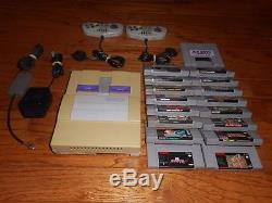Super Nintendo MARIO/YOSHI BUNDLE SNES console with 16 games & controllers lot